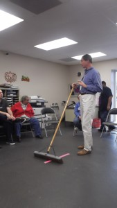 How to properly use a push broom.
