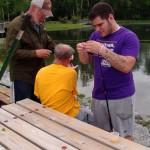 Eli baiting a hook
